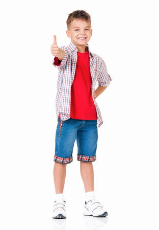 young boy smiling: Stylish boy over white background full length showing thumbs up