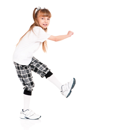 hip: Little girl in white T-shirt dancing isolated on white background
