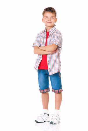 arms folded: Little boy with hands folded isolated on white background Stock Photo