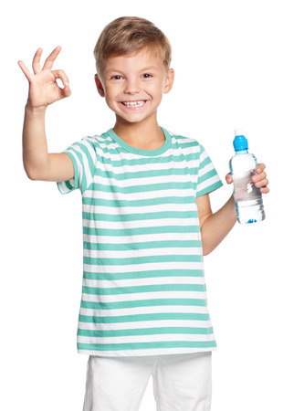 white water: Happy boy with bottle of water isolated on white background