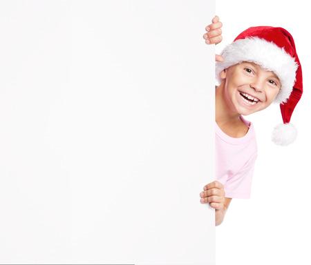 white hat: Portrait of happy little boy in Santa hat with white blank