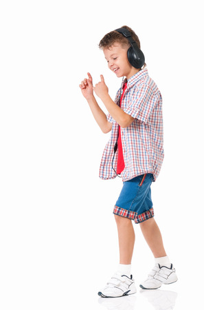 9 10 years: Happy teen boy with headphones, isolated on white background Stock Photo