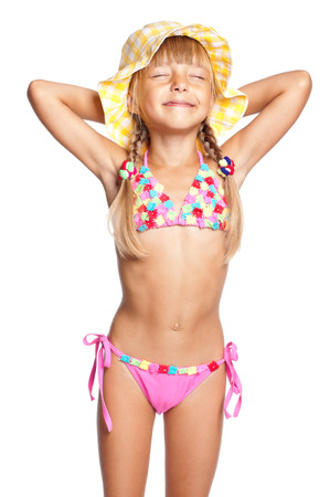 Happy little girl in swimsuit and hat isolated on white background Stock Photo