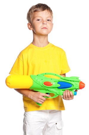 watergun: Boy with plastic water gun isolated on white background Stock Photo