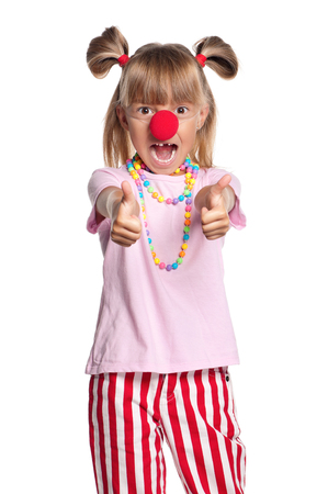 clown nose: Little girl with clown nose showing thumbs up gesture, isolated on white background