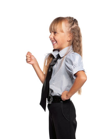 Happy schoolgirl showing a gesture of the fig, isolated on white background Stock Photo