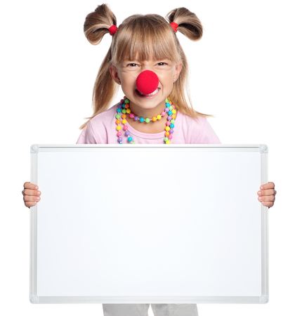 clown nose: Little girl with clown nose showing white blank isolated on white background