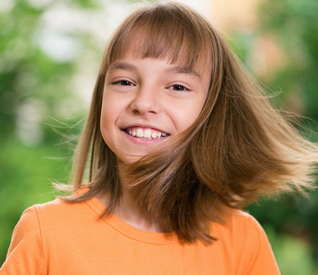 flying hair: Outdoors portrait of beautiful happy girl with flying hair