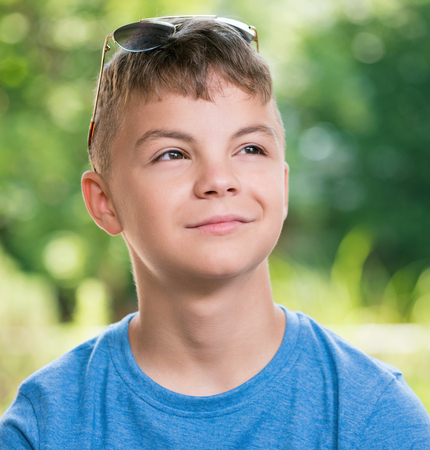 Portrait of a teen boy 12-14 year old with sunglasses Stock Photo