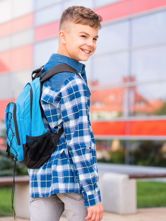 school boy: Outdoor portrait of happy teen boy 12-14 years old with backpack. Young student beginning of class after vacation. Back to school concept.