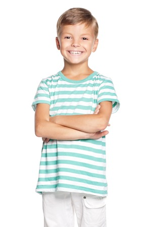 white back: Portrait of proud young boy. Happy cute kid with arms folded. Smiling schoolboy isolated on white background.
