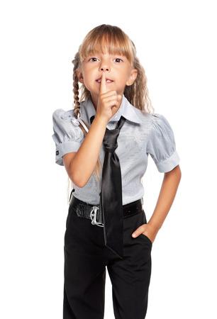 sh: Little girl showing hand silence sign Stock Photo