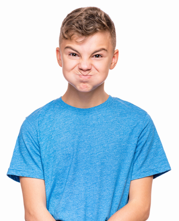 grouch: Emotional portrait of teen boy Stock Photo