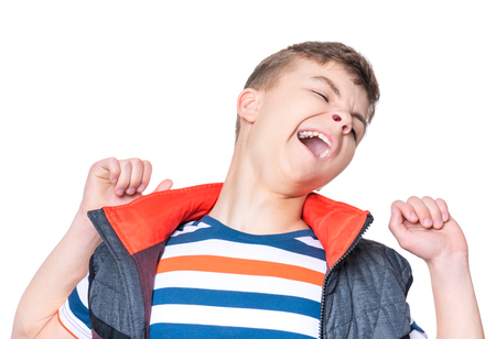wearied: Emotional portrait of caucasian teen boy. Young sleepy handsome teenager yawning stretching arms. Studio shot - isolated on white background. Stock Photo