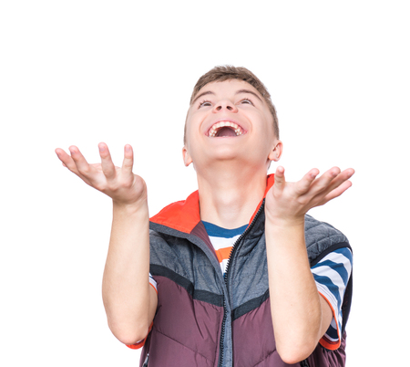 upgrowth: Cheerful handsome teen boy with raising hands waiting to catch something. Emotional portrait of caucasian happy cute laughing male child, isolated on white background.