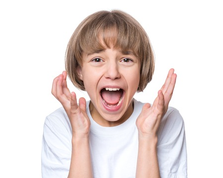 painfully: Close-up emotional portrait of caucasian girl crying painfully and screaming. Funny cute child in white blank t-shirt looking at camera, isolated on white background.