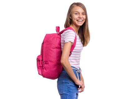 Student teen girl with backpack looking at camera. Portrait of cute smiling schoolgirl with hands in pockets, isolated on white background. Happy child Back to school.