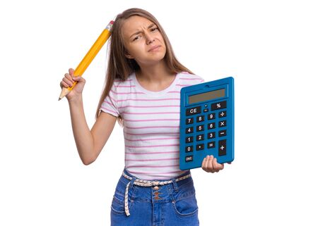 Thoughtful student holding big calculator and pencil. Portrait of funny cute teen girl, isolated on white background. Unhappy dreaming child Back to school. Stockfoto