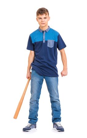 Full length portrait of young caucasian teen boy holding a baseball bat. Funny teenager hooligan looking at camera, isolated on white background. Handsome child playing baseball.