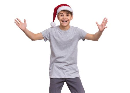 Christmas teen boy in Santa Hat isolated on white background. Stock Photo