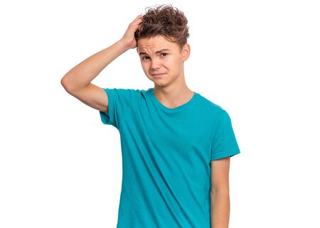 Portrait of unhappy teen boy, stressed with hand on head. Cute young caucasian teenager fears and upset for mistake. Sad child looking at camera with shocked, isolated on white background.