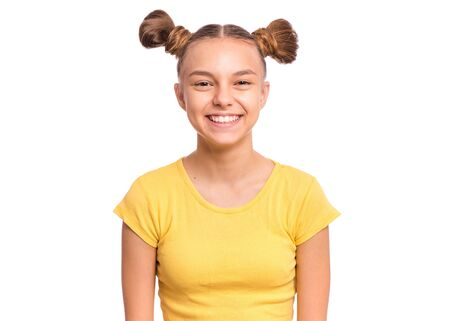 Portrait of happy teen girl with funny hairstyle, isolated on white background. Smiling child looking at camera. Beautiful young caucasian teenager.