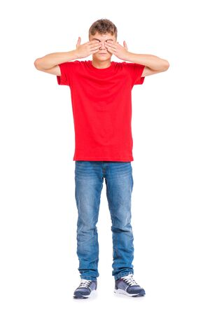 I do not see, do not speak, can not hear anything - full length portrait of young caucasian teen boy. Funny teenager 14 year old. Handsome child isolated on white background.