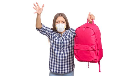 Concept of coronavirus quarantine. Child wearing medical protective face mask to health protection from influenza virus. COVID-19. Portrait of Student teen Girl with bag, isolated on white background.