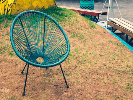 Turquoise garden chair at the lounge zone. Somewhere quiet. Rest outdoor area