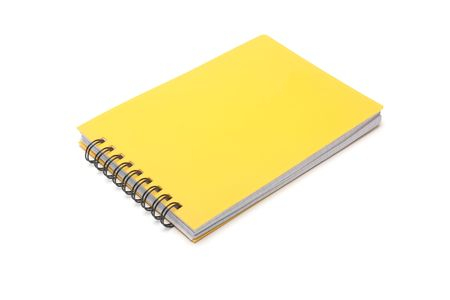 spiral ring-bound yellow notepad, on a white background Stock Photo - 6536450