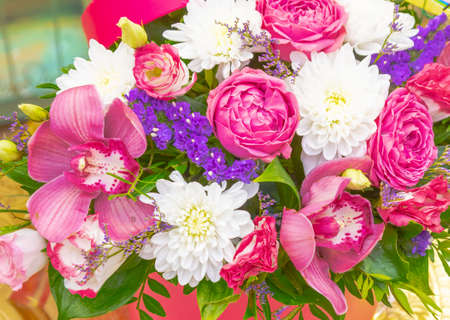 bright bouquet of pink roses and orchids. Banco de Imagens