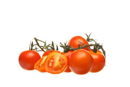 Cherry tomatoes isolated on a white background. Close-up.