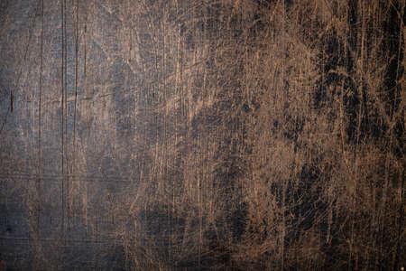Dark brown wooden background handmade. Top view.