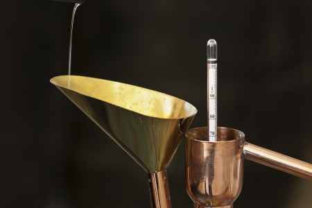 instrument to measure the degree of alcohol in a distillery photo