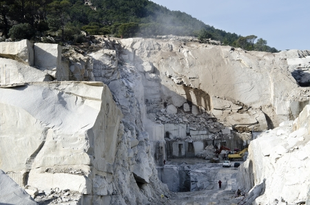 machines working in a granite quarry in madrid Stock Photo