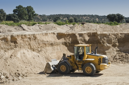 gravel pit: excavator used for the extraction of sand in a gravel pit