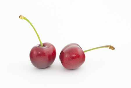 incommunicado: Two red  sweet cherries Canadian variety Sandra Rose  Stock Photo
