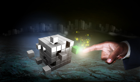 Touching a solution cube by a Business man, during the process of problem solving