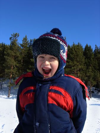 ifestyle: Winter. The boy is strongly pleased                                Stock Photo
