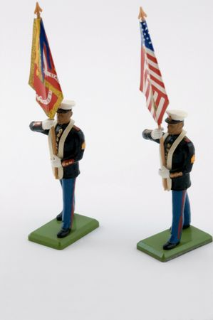 Two US Marines carrying the Stars & Stripes plus Corps flag