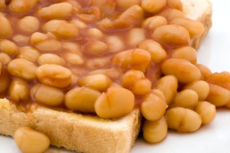 A plate of baked beans in a tomato sauce. Stock Photo