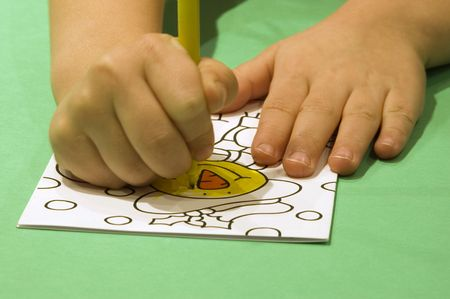 A young child creating a Christmas card. Stock Photo