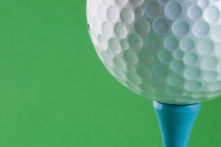 Golf ball sat on a red tee peg  Stock Photo
