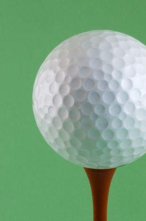 Golf ball sat on a red tee peg