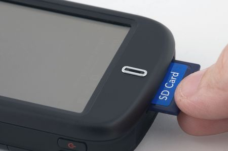sd: Man inserts SD card Stock Photo