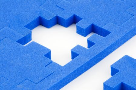 Blue interlocking puzzle pieces on a white background with the solution in sight