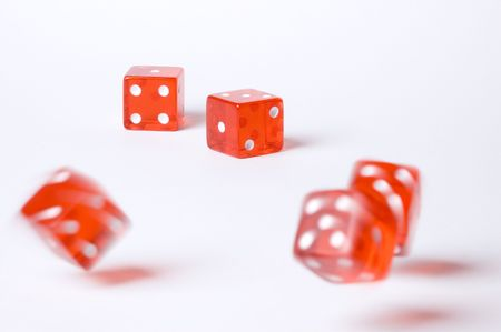 Five red poker dice on a white background