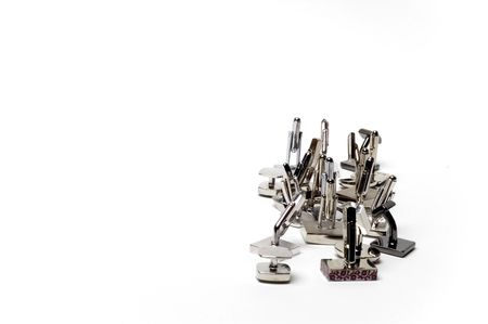 Cuff links isolated on a white background