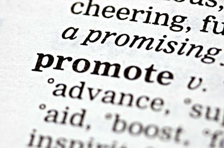 The word promote written in a thesaurus