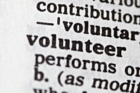 willing: The word volunteer written in a thesaurus  Stock Photo